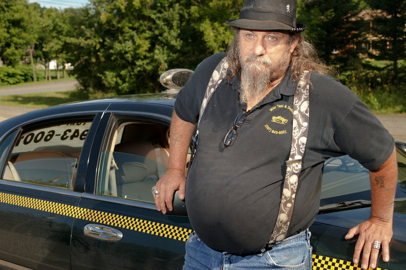 """Mike Anderson, who owns Milo Taxi, said he knows most of the local railroad workers who have been laid off. Many of them work at the railroad's maintenance shop in Derby, a neighborhood in Milo. """"They knew it was coming the minute (the disaster) happened,"""" he said."""