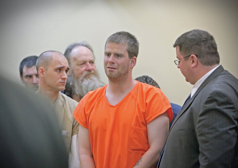 Bryan Wood, center, stands next to his attorney Steven Carey, right, during his arraignment in Lewiston District Court on arson charges on May 13. Wood, who has been found incompetent to stand trial, likely will be released at some point after charges are dropped. Brian Morin, left, was also arraigned on arson charges that day.