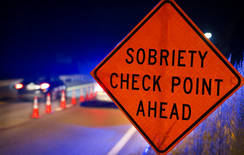 A sign warns motorists of a sobriety checkpoint on Route 1 in Brunswick.