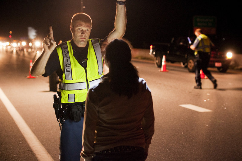 Cumberland Police Officer Ryan Martin, below, conducts a field sobriety test Friday.