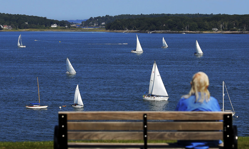 Dolores Wilhoite of Portland watches the MS Regatta from the Eastern Promenade on Saturday.