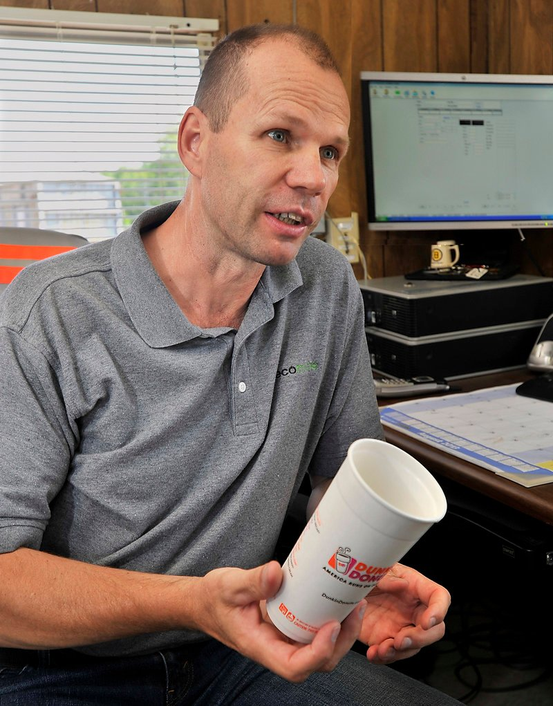 Ecomaine manager John Morin says the Portland waste management company would be able to recycle the new Dunkin' Donuts cup, despite a thin coating on the inside.