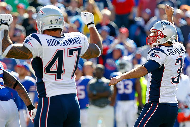 Stephen Gostkowski, right, celebrates with teammate Michael Hoomanawanui after kicking the winning field goal with 5 seconds left in the game Sunday at Orchard Park, N.Y. The Pats won, 23-21.