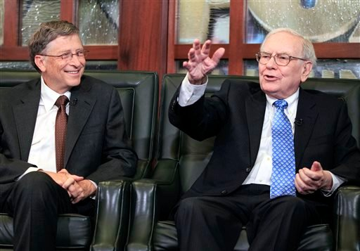 Richest of the rich: Microsoft co-founder Bill Gates and Berkshire Hathaway CEO and Chairman Warren Buffett appear at a Berkshire Hathaway shareholders meeting in May.