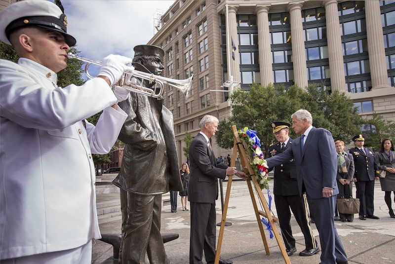 Defense Secretary Chuck Hagel, right, and Joint Chiefs Chairman Gen. Martin Dempsey, second from right, present a wreath at the Navy Memorial in Washington to remember the victims of Monday's deadly shooting at the Washington Navy Yard, Tuesday, Sept. 17, 2013. (AP Photo/J. Scott Applewhite)