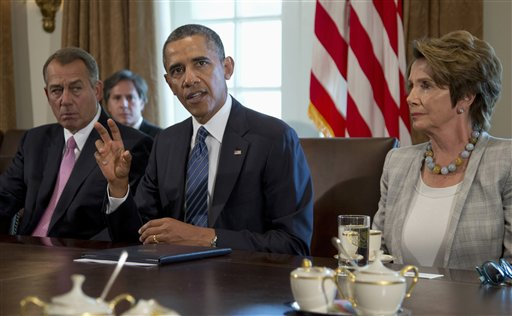 President Barack Obama, flanked by House Speaker John Boehner of Ohio and House Minority Leader Nancy Pelosi of California, speaks to media in the Cabinet Room of the White House on Tuesday, before a meeting to discuss the situation in Syria.