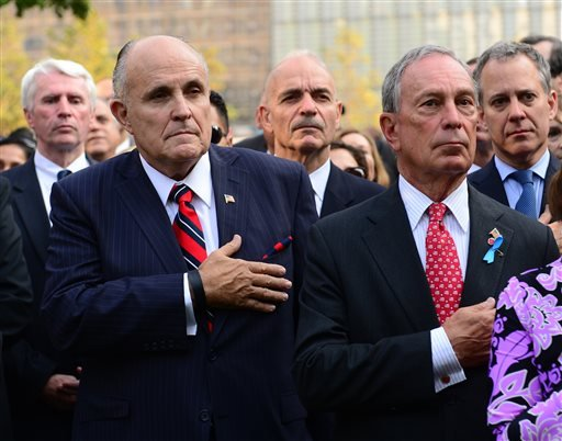 Former New York Mayor Rudolph Giuliani, foreground left, and Mayor Michael Bloomberg, right, attend ceremonies at the 9/11 Memorial marking the 12th Anniversary of the attacks on the World Trade Center, in New York, on Wednesday.
