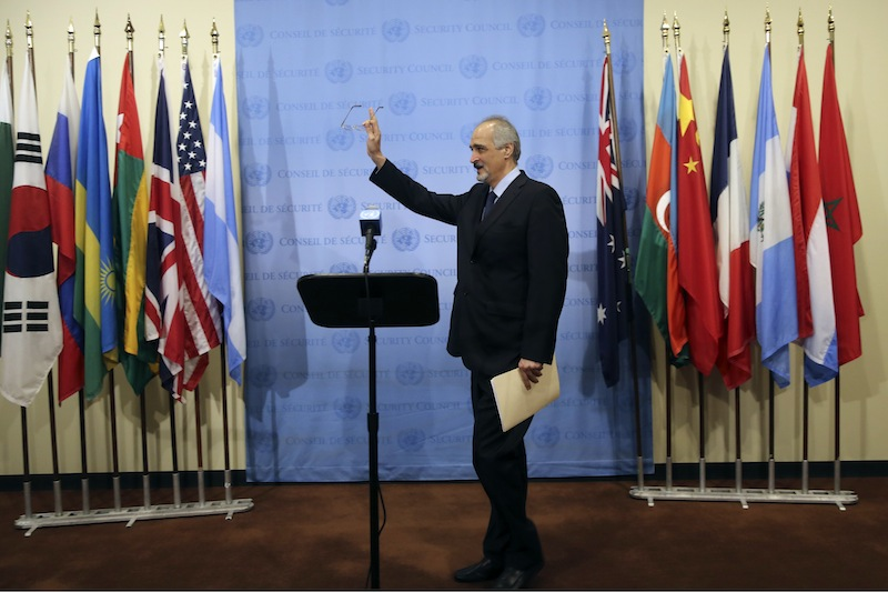 Syria's Ambassador to the United Nations Bashar Ja'afari speaks to reporters, Thursday, Sept. 12, 2013 at United Nations headquarters. (AP Photo/Mary Altaffer)