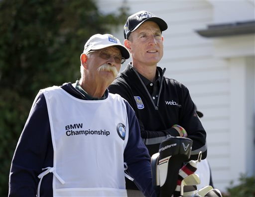 "Jim Furyk, right and his caddie Mike ""Fluff"" Cowan look out from the third tee during the second round of the BMW Championship golf tournament at Conway Farms Golf Club in Lake Forest, Ill., Friday, Sept. 13, 2013. Furyk posted a single round 59, tying the PGA Tour record. (AP Photo/Charles Rex Arbogast)"