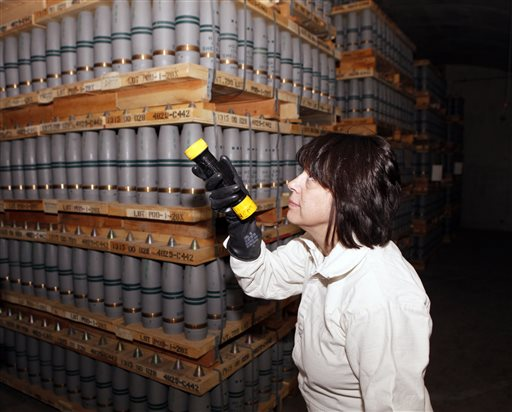 In this January 2010 photo Debra Michaels, chemical operations manager, inspects mustard agent shells in one of the bunkers at the Pueblo Army Chemical Storage facility in Pueblo, Colo.