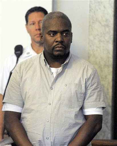 Ernest Wallace appears in district court in Attleboro, Mass. in this July 26, 2013, photo.