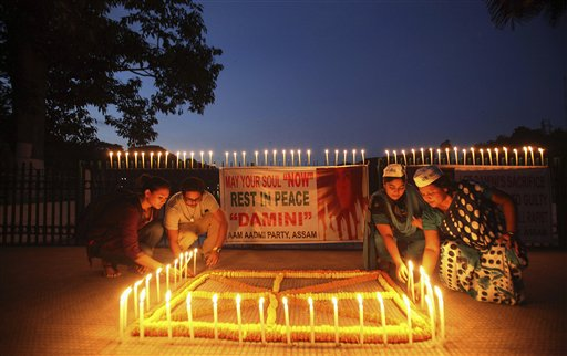 People in n Gauhati, India, light candles to mark the verdict after a judge announced death sentences Friday for four men convicted in the rape and murder of a student on a bus in New Delhi last year.