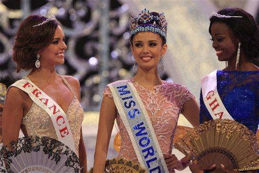 Newly crowned Miss World, Megan Young of the Philippines, center, with second runner-up, Miss France Marine Lorpheline, left, and third runner-up, Miss Ghana Carranza Naa Okailey Shooter, smile during the conclusion of the Miss World contest in Nusa Dua, Bali, Indonesia, today.