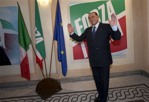 "Former Italian Premier Silvio Berlusconi pauses for photographers Thursday at the inauguration of his ""Forza Italia"" (Go Italy) party's new headquarters in Rome. Government ministers in Berlusconi's party announced Saturday their intentions to resign, a move that raises tension in the uneasy coalition government and increases the possibility of early elections."