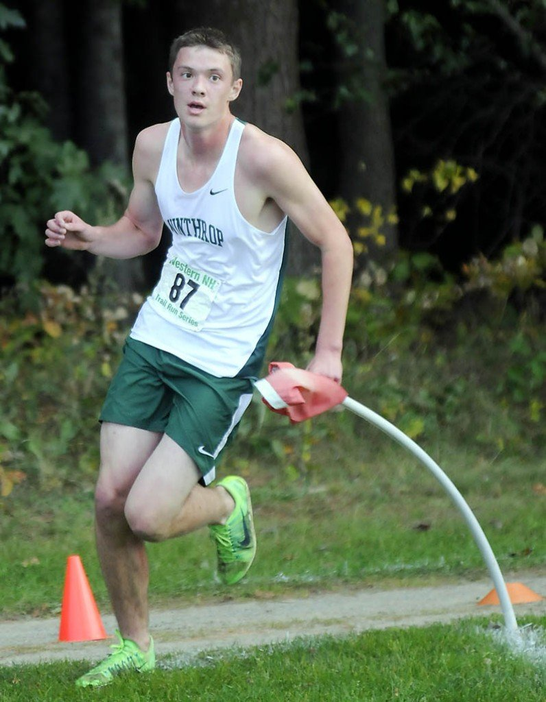 FINISHING KICK: Winthrop High School's Ben Allen runs to the finish line during a cross country meet Wednesday at the University of Maine at Augusta. Allen finished second.
