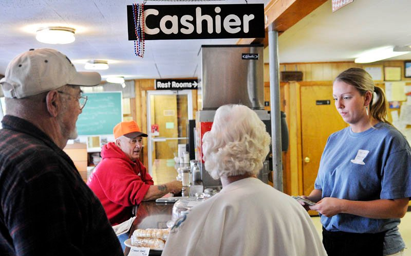 Hi-Hat waitress Caitlyn Laflin, right, gives customers change today on the eve of a meals, lodging and sales tax increases in Maine. Meals and lodging will increase from 7 percent to 8 percent and the sales tax will rise to 5.5 percent from 5 percent.