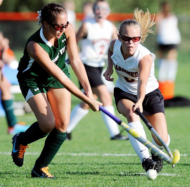 STICK WORK: Mount View's Brittany Moody, left, has a shot blocked by Gardiner's Emily Malinowski on Wednesday during a field hockey game in Gardiner. The Tigers won 5-2.