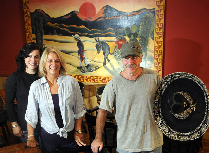 Jim and Deborah Remley are opening Bravo's Southwest Bistro in Hallowell with their daughter, Kate Remley, left. The family was working to prepare the restaurant today.