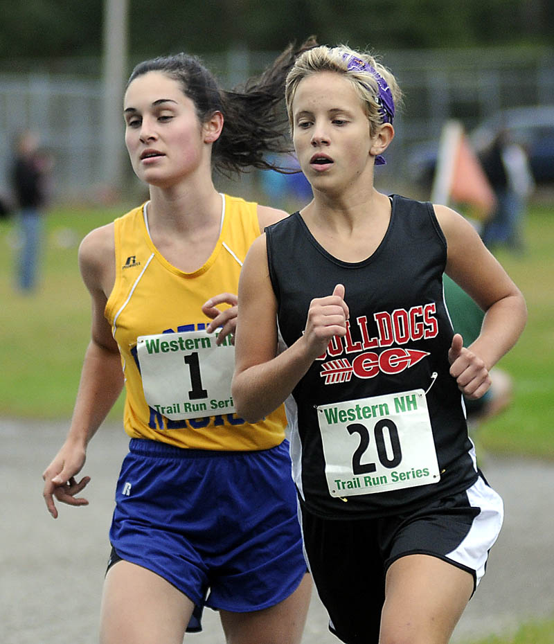 Hall-Dale High School's Emma Wilson, right, runs next to Boothbay High School's Sophie Thayer during a cross country meet Wednesday at the University of Maine in Augusta. Thayer won the race and Wilson finished second.