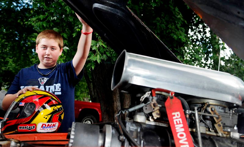 Cameron Folsom, 14, helped build and race a car to honor the memory of Jordan Ellis, 19, an Augusta teen who died of an apparent overdose in May. Folsom discussed the vehicle at his Augusta home on Thursday.