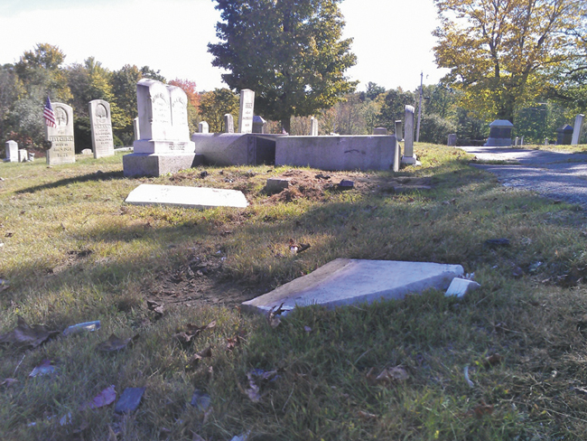 Police say a mother and daughter caused an estimated $35,000 of damage to headstones in Monmouth Ridge Cemetery on Friday.