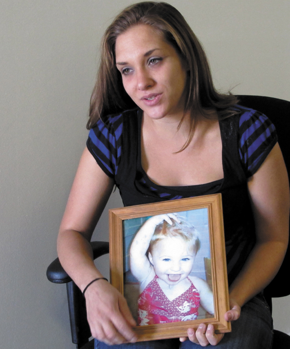 Trista Reynolds, 25, holds a photo of her 20-month-old daughter, Ayla Reynolds, during an interview with the Associated Press in Westbrook, Maine, Tuesday. Reynolds, whose daughter went missing in December of 2011, says she's going to release more information she's been told by investigators in hopes of calling attention to the case and bringing it to a resolution.