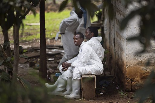 A morgue worker waits outside in the grounds of the mortuary in Nairobi, Kenya, on Wednesday. On Friday, Karen Wambui identified her son as the last person to be confirmed killed during the Sept. 21, al-Shabab terrorist assault on the Westgate Mall in Nairobi, Kenya.