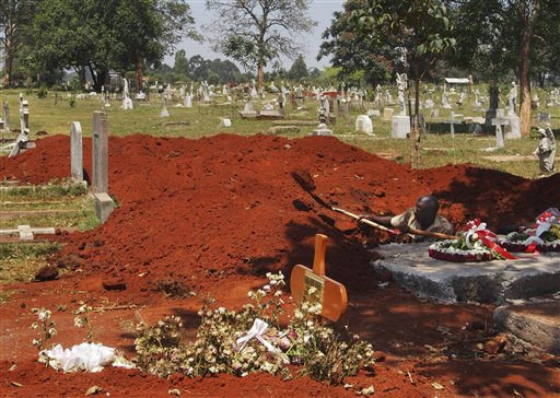 A gravedigger digs additional graves with a shovel, in anticipation of an increased number of burials both of Westgate Mall attack victims and of those deceased from other causes, at the main cemetery in Nairobi, Kenya, on Saturday.