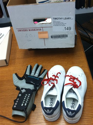 This undated photo provided by the New York Public Library shows Timothy Leary's Nintendo power glove and sneakers.