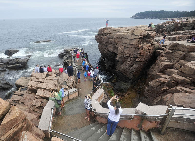 Crowds of people gather around Thunder Hole at Acadia National Park in Bar Harbor in July 2013. The park may need to close at the height of the fall foliage season if congress can't reach a deal on federal spending.