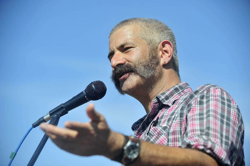 """Sandor Katz, author of """"Wild Fermentation: The Flavor, Nutrition and Craft of Live Culture Food,"""" speaks during the keynote address at the Common Ground County Fair in Unity today."""