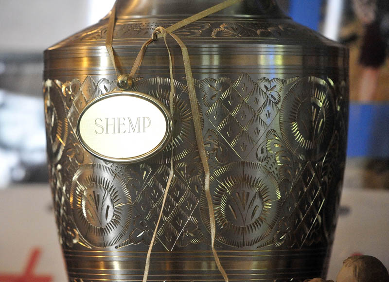 """An urn containing the remains of Christopher Nelson and a tag displaying his nickname, """"Shemp,"""" rest on a television stand at the family's Pease Hill Road residence in Anson on Wednesday."""