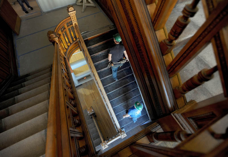 Construction workers with Sheridan Construction climb the grand staircase in the Gerald Hotel in downtown Fairfield on Sept. 18.