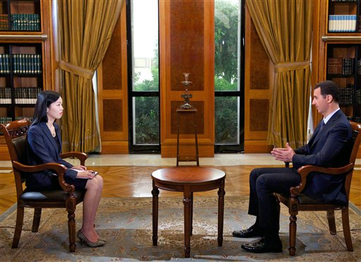 In this photo released by the Syrian official news agency SANA, Syrian President Bashar Assad speaks during an interview with Chinese state CCTV, in Damascus on Monday.