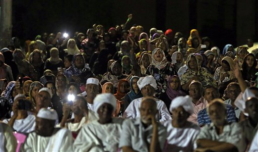 Sudanese anti-government protesters chant slogans during a demonstration in Khartoum, Sudan, on Sunday. Thousands of Sudanese protesters took to the streets in night march in the capital Khartoum late Sunday.