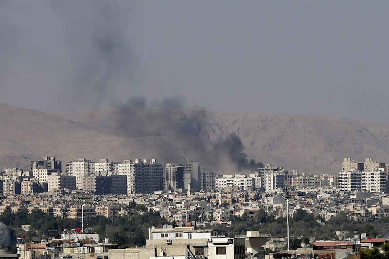 """Black columns of smoke from heavy shelling in Barzeh, a suburb of Damascus, Syria, Friday, Aug. 23, 2013. Secretary-General Ban Ki-moon said Friday, Sept. 13, 2013 he believes there will be """"an overwhelming report"""" from U.N. inspectors that chemical weapons were used in an attack in Syria on Aug. 21. (AP Photo/Hassan Ammar)"""