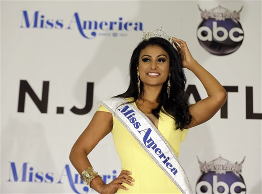 Miss America Nina Davuluri poses for photographers following her crowning in Atlantic City, N.J., on Sunday. For some who observe the progress of people of color in the U.S., Davaluri's victory in the pageant shows that Indian-Americans can become icons even in parts of mainstream American culture that once seemed closed.
