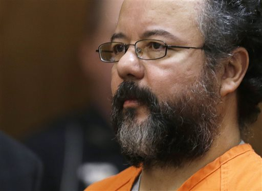 Ariel Castro sits in a Cleveland, Ohio, courtroom Aug. 1 during the sentencing phase of his trial. Castro, who held 3 women captive for a decade, has committed suicide, prison officials said.