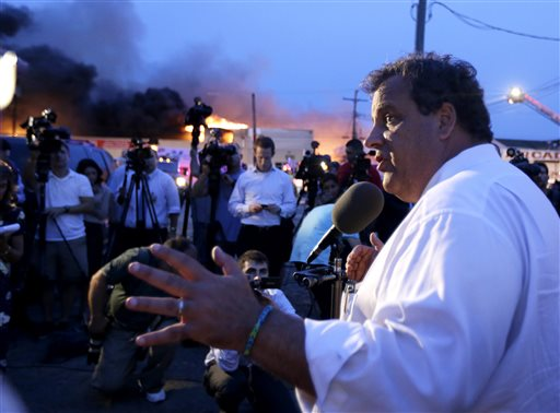 New Jersey Gov. Chris Christie addresses the media near the area hit by a massive fire on Thursday in Seaside Park, N.J.