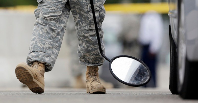 "In this Aug. 27, 2013 file photo, a mirror is used on a vehicle at a security checkpoint to enter the Lawrence William Judicial Center as the sentencing phase for Maj. Nidal Hasan continues in Fort Hood, Texas. Hasan was convicted of killing 13 of his unarmed comrades in the deadliest attack ever on a U.S. military base. The rampage Monday, Sept. 16, 2013, at the Washington Naval Yard shocked the military, just as the attack at Fort Hood did. Defense Secretary is ordering a review of base security worldwide, and the issuing of security clearances that allow access to them, vowing: ""Where there are gaps, we will close them."" (AP Photo/Eric Gay, File)"