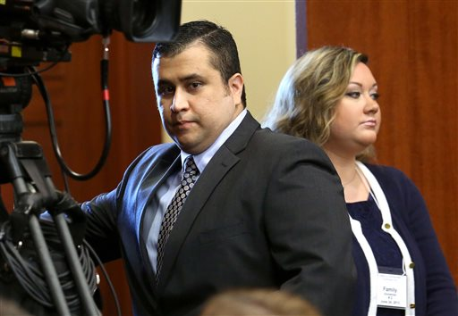 George Zimmerman arrives in Seminole circuit court with his wife, Shellie, in this June 24, 2013, photo.