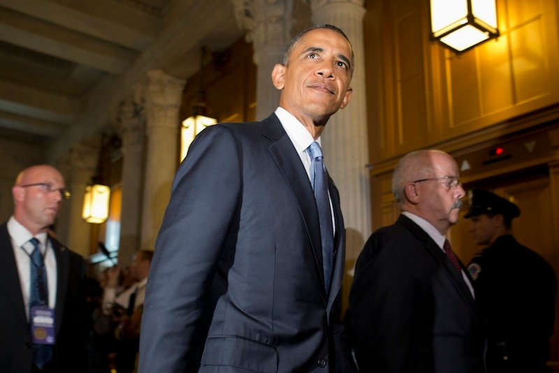 President Barack Obama, accompanied by Senate Sergeant at Arms and Doorkeeper Terrance Gainer, right, leaves a meeting with congressional Republicans on Capitol Hill in Washington, Tuesday, Sept. 10, 2013, where they discussed Syria. On Tuesday night, the president will address the nation on Syria. (AP Photo/Jacquelyn Martin)