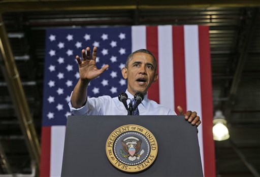 "President Barack Obama speaks at the Ford Kansas City Stamping Plant in Liberty, Mo., on Friday. ""If Congress doesn't pass this debt ceiling in the next few weeks, the United States will default on its obligations. That's never happened in American history. Basically, America becomes a deadbeat,"" he said."