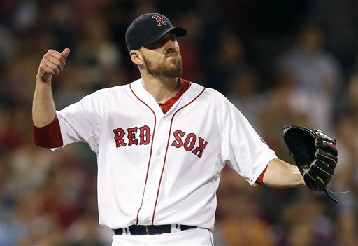 Boston Red Sox's John Lackey reacts after the final pop out by Baltimore Orioles' Adam Jones in the ninth inning of a baseball game in Boston, Thursday. Lackey pitched a complete game and the Red Sox won 3-1.
