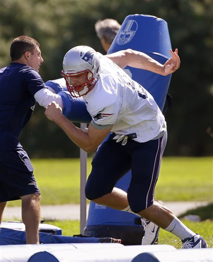 New England Patriots tight end Rob Gronkowski (87) pushes off a block during practice at the NFL football team's facility in Foxborough, Mass., Wednesday Sept. 4, 2013. The Patriots open their regular season against the Buffalo Bills on Sunday. (AP Photo/Stephan Savoia) Gillette Stadium