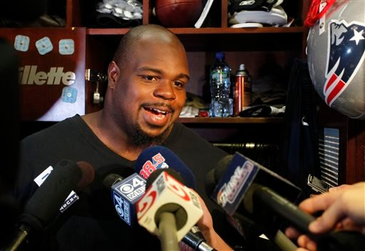 New England Patriots defensive tackle Vince Wilfork speaks with the media in the locker room at Gillette Stadium in Foxborough, Mass., Tuesday, Sept. 10, 2013. The Patriots play the New York Jets on Thursday in Foxborough. (AP Photo/Stew Milne)