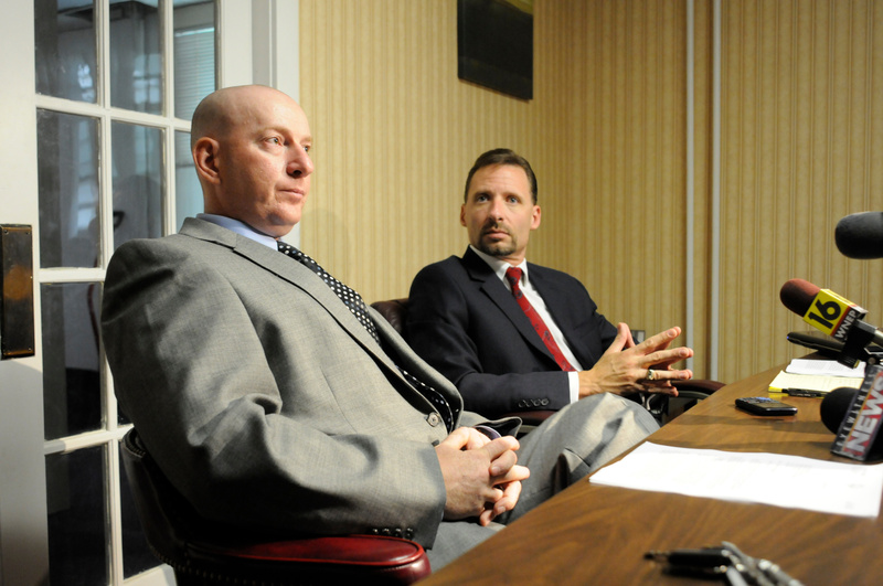 Gilberton Police Chief Mark Kessler, foreground, and his attorney Joseph P. Nahas speak during a news conference in August.