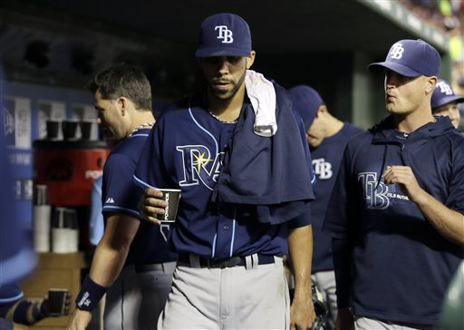 Tampa Bay Rays' David Price gets a drink in the dugout during the sixth inning of an American League wild-card tiebreaker baseball game against the Texas Rangers Monday, Sept. 30, 2013, in Arlington, Texas. (AP Photo/Tony Gutierrez)