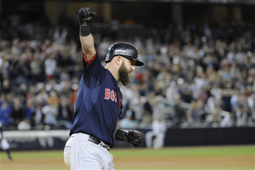 Boston Red Sox batter Mike Napoli reacts as he rounds the bases after hitting a grand slam home run during the seventh inning of a baseball game against the New York Yankees Friday, Sept. 6, 2013, at Yankee Stadium in New York. (AP Photo/Bill Kostroun)