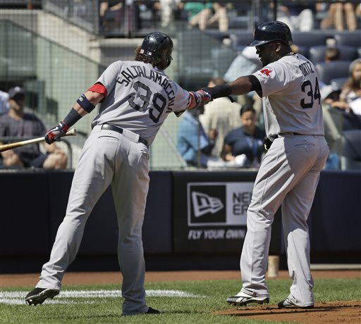 IT'S ON: Boston Red Sox's David Ortiz, right, celebrates with teammate Jarrod Saltalamacchia after scoring on double hit by Mike Carp on Sunday against the New York Yankees in New York. The Red Sox open a key series with the Tampa Bay Rays tonight.